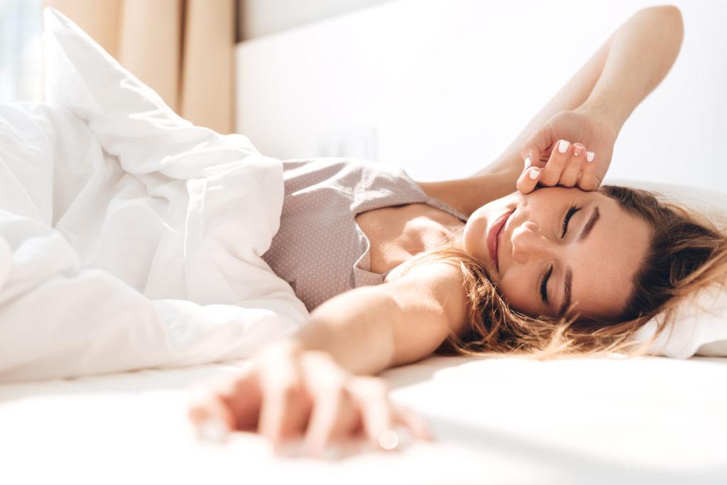 woman sleeping with melatonin