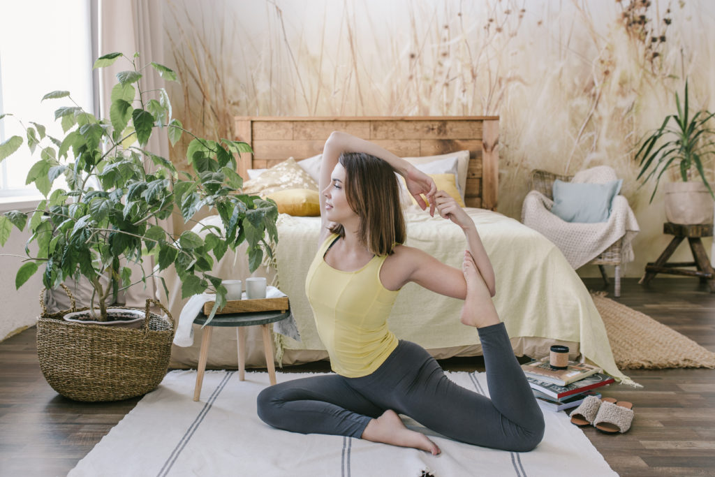 Stretching Lady in a Bedroom