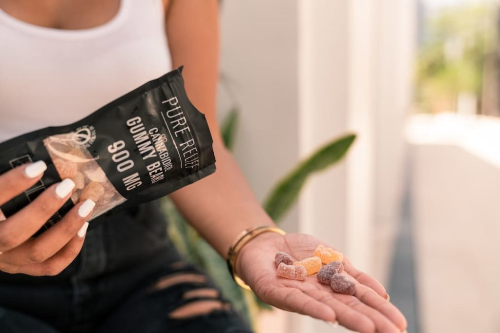 Girl holding Pure Relief Night Time gummies