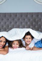 Happy family under the blanket